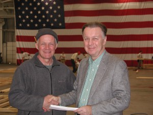 John McClintick (left), event coordinator with Peter Dachowski, president and CEO, CertainTeed Corp. at Builders' Competition