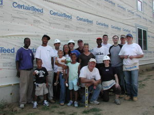 Habitat volunteers and families