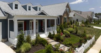 Seen here: Restoration Classic siding in Pacific Blue and Landmark shingles in Birchwood