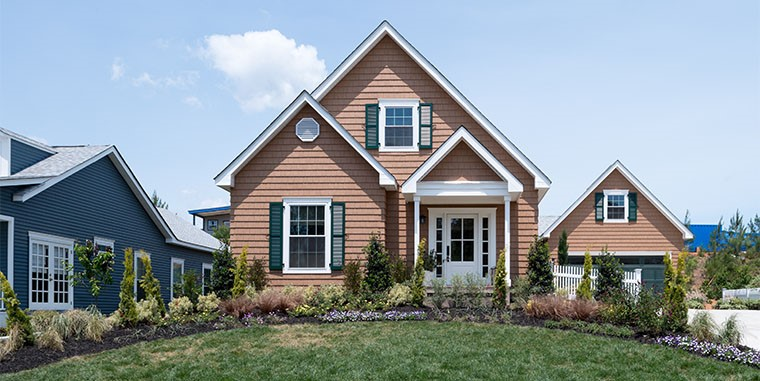 Use ornamental grasses and plantings that match the exterior of your home for a beautiful look and lots of curb appeal.